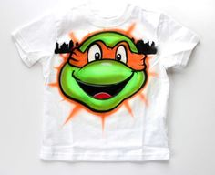 michelangelo turtle face - airbrush personalized child t shirt city background  #Anvil #PersonalizedTee