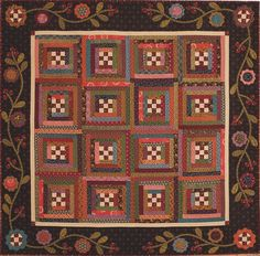 "SPRIGS & TWIGS by Kim Diehl: Combining traditional patchwork design with folk-arty appliqué is what makes this charming quilt a Kim Diehl specialty. An abundance of prints within a small quilt (60"" square) packs a delightful wallop."