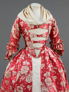 This gown features a rose-red silk with trails of ivory flowers woven in a complex technique. The gros de tours silk, dates from the but the gown was been remade into the style of the. 18th Century Dress, 18th Century Costume, 18th Century Clothing, 18th Century Fashion, Vintage Outfits, Vintage Gowns, Vintage Mode, Vintage Fashion, Rococo Fashion