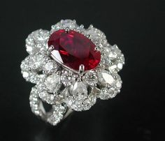 PRIMA GEMS. A stunning Pigeon's blood unheated Siamese ruby with diamond ring.