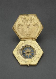 Réunion des musées nationaux - French astronomical compendium ~ Includes the coat of arms and motto of Charles X. It is composed of a nocturnal, a list of latitudes in degrees of twelve cities in Europe, a compass, an azimuth pinnules (for sighting), and a double scale to assist in the measurement of the unequal hours in a day throughout the year - dates to 3rd quarter of the 16th century. ( Louvre)