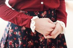 Adorable outfit! Navy and red floral skirt, red blouse with frilly sleeves