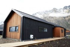 Modern And Stylish Exterior Design Ideas - Stylendesigns - Cedar and Black Cladding Alpine Tray Roofing Wing Walled Gables Eco Home House Exterior - Black House Exterior, Exterior House Colors, Modern Exterior, Exterior Design, Gray Exterior, Siding Colors, Modern Garage, Modern Barn, Exterior Paint