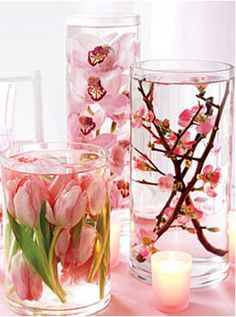 very cool simple way to display flowers using dollar store glasses and distilled water