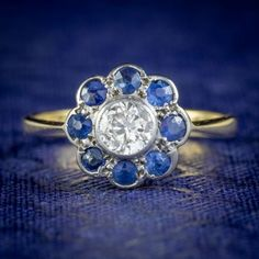 ANTIQUE EDWARDIAN DIAMOND SAPPHIRE CLUSTER RING 18CT GOLD PLATINUM CIRCA 1905 cover Sapphire Rings, Blue Sapphire, Antique Rings, Antique Jewelry, All Gems, Free Ring, Gold Platinum, Cluster Ring, Diamond Cuts