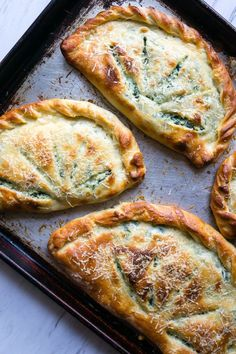 Ricotta and Spinach Calzones - WomansDay.com