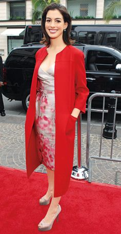 Love the red coat. 200 Celebrity Looks We Love - Anne Hathaway in Valentino, 2009 from #InStyle