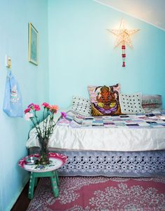 Fun, colorful indie-style bedroom full of multi-colored textiles