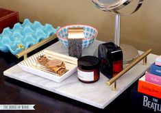 Use an inexpensive marble tile to make an elegant DIY marble tray. A quick, easy, and inexpensive project that gives you a lot of bang for your buck! Marble Tray, Marble Tiles, Tiling, Leftover Tile, Home Crafts, Diy Crafts, Shadow Box Frames, Porcelain Tile, Diy Woodworking