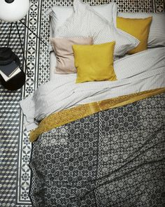 Moroccan textures can be found both in the tiling and the blanket fabrics.