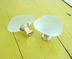 Beach glass stone knobs.  I can see these in a beach house bathroom.