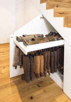 Special pull-out for the gentle storage of boots in the built-in cupboard under the stairs. Custom-made solution from Alpnach Norm. Built-in wardrobes made to measure Maria Maria Haus Special pull-out for the gentle storage of boots in t Diy Storage Pods, Attic Storage, Storage Shelves, Storage Stairs, Basement House, Basement Bedrooms, House Stairs, Small Space Interior Design, Interior Design Living Room