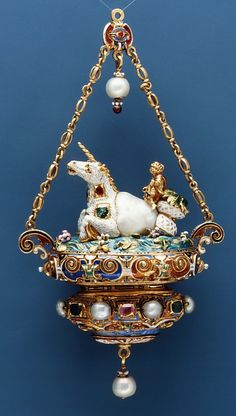 Unicorn pendant: Baroque pearl mounted with enameled gold set with pearls, emeralds and rubies and with pendent pearls.19th century (probably) French .