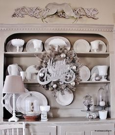 Gray hutch with milk glass and vintage Christmas decorations.