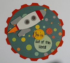 """""""You're Out of This World"""" is from the *Build a Valentine* stamp set. The space ship is from the Just Because Cards cartridge. The card base is a cut from the Elegant Edges cartridge. I used the """"Boyfriend"""" mini deck paper from Cosmo Cricket."""