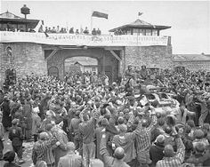 Survivors cheer American soldiers as they pass through the main gate of the camp to liberate them.     http://www.ushmm.org/outreach/en/article.php?ModuleId=10007724#