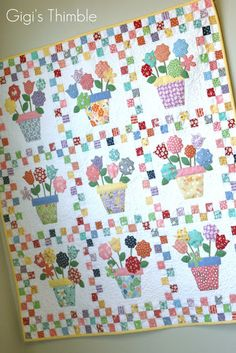 A Little Bit Biased: Pot 'o Flowers Quilt.....if I made it, I would double the size of the applique and blocks and maybe add another row of three to make a larger quilt.  I would definitely use the heat n bond method of applique in this one....oh so pretty!