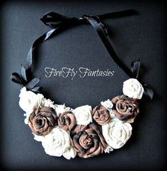 Eco Chic -  Up cycled Cheetah Print Rose Flower Bib Necklace made from recycled t shirts and ribbon. $28.00, via Etsy.
