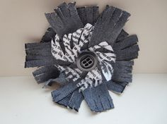 Check out this item in my Etsy shop https://www.etsy.com/uk/listing/177402631/shabby-chic-flower-brooch-grey-denim