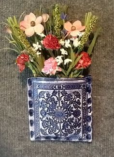 Clay wall pocket by Pretty Pottery.  Order online at Etsy: PrettyPotterybyTC