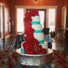Wedding cake, Tiffany blue and red wedding cake, red roses, Tiffany blue ribbon. https://m.facebook.com/KellyQLovesCake