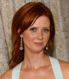Cynthia Nixon with long red hair, peachy cheeks, and peachy-rose lips. Doesn't she look beautiful?