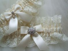 Ivory Chantilly lace garter set. Embellished with bow and a sparkling rhinestone jewel.Toss garter made to match keepsake garter. ~~~~~~~~~~~~~~ All of my garters have a small blue bow stitched inside