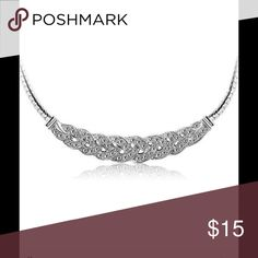 Silver tone Rhinestone Necklace w/ Twisted Chain Beautiful Silvertone Woven Placket with rhinestones are centered in this 18-20 inch necklace with a twisted snake chain and lobster claw clasp closure! Jewelry Necklaces
