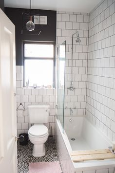 Simple, minimal bathroom with metro tiles
