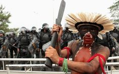 BRAZIL - A Brazilian indigenous man participates in a protest against the construction of the Belo Monte hydroelectric plant. Picture: REUTERS/Ueslei Marcelino