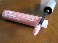 Aveda's rasberry tea lip glaze is the most natural looking hint of color and shine. It smells amazing.