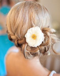 like this, but maybe waterfall braid around to the side for a low side pony and then a peony for the flower?