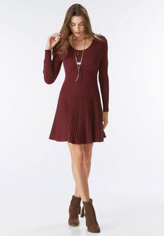 Feel fabulous and feminine in this adorable sweater dress, featuring a mixed ribbed knit fabrication and flattering fit and flare silhouette.         Long sleeves     81% rayon, 19% nylon     Machine wash     Imported