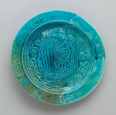 Turquoise Dish with Carved Arabic Inscription in Floriated Kufic Reading, The Cloisters, NYC
