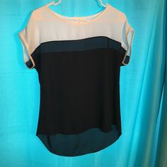 Color block shirt Navy and white color block shirt. Fast shipping no trading no off site sale will be made a'gaci Tops Blouses