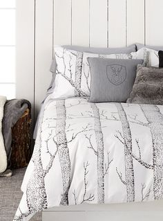 """Designed in our studios exclusively for Simons Maison     Very trendy rustic pattern with tall birch tree trunks printed in contrasting charcoal on a cream background.      The set includes:   Twin: 1 duvet cover 66"""" x 90"""", 1 pillow sham 20"""" x 26""""  Double: 1 duvet cover 84"""" x 90"""", 2 pillow shams 20"""" x 26""""  Queen: 1 duvet cover 90"""" x 95"""", 2 pillow shams 20"""" x 30""""  King: 1 duvet cover 108"""" x 95"""", 2 pillow shams 20"""" x 36"""""""