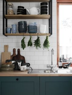 Love how this kitchen space combines wood, fresh herbs, turquoise colours and open shelves #scandinavianhome #interiorinspiration