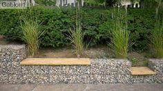 gabion retaining wall capped with wooden seating