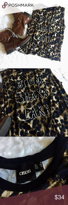 "🆕 ASOS: Boom Shaka Laka Tee Like new!  Boom Shaka Laka cheetah/leopard tank top from ASOS size 8.  Bust: 39"", length: 23.5"".  Style with a pair of skinnies and combat boots.  No trades.  Make me a reasonable offer! Asos Tops Tank Tops"