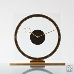 Art Deco Kienzle table clock in the Bauhaus modernism style, Germany  Manufacturer: Kienzle, Material: 	Gold-plated brass, glass, 8 days working mechanism, 1934