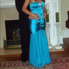Mermaid style Prom Dress Turquoise mermaid style prom dress from Cache. Worn once. Pictures 3 and 4 show some snags in the material. Dress fit me and I'm 5'1. Cache Dresses Prom