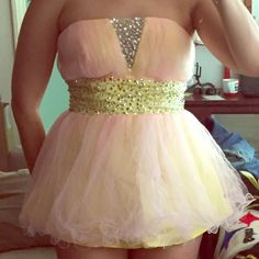 Pink and yellow tulle and sequin corset top, 6 Strapless too with pink tulle overlay and yellow satin lining and sequin detail, no brand or size tag, I am a size 6 and fits perfectly, great condition, back zipper Tops