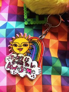 Use adult coloring books to make easy and adorable backpack charms with the help of Shrinky Dinks. #JenniferPerkins #diy #diyproject #crafts #craftsforkids #crafty #CreateEveryday #DoItYourself