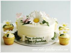Make a simple yet sophisticated daisy cake and daisy cupcakes.