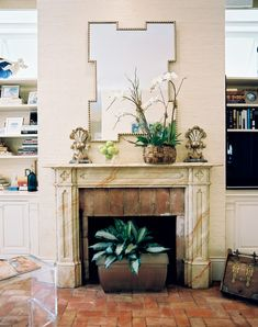Beige Fireplace - Brick flooring and a faux-marble mantel in a family room. Using narrow tiles.