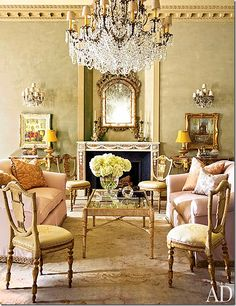 Houston home designed in 1930 by the renowned architect John F. Staub. My favorite room is the music room with its blush sofas and dainty, feminine antique chairs.