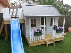 Kids playhouse slide kids play area girls 15 Pimped Out Playhouses Your Kids Need In The Backyard Backyard Playhouse, Build A Playhouse, Backyard Playground, Backyard For Kids, Playhouse Slide, Playhouse Ideas, Playhouse Decor, Garden Kids, Childrens Playhouse
