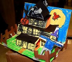 smART Class: Spooky Houses elementary art lesson project Halloween paper sculpture origami pop-up 3D