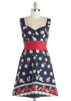 Color is Key Dress in Strawberries. Your look can include the cutest beaded headband, the coolest vintage handbag, and an eye-catching pair of kitten heels, but lets face it - the adorable fruit-and-floral print of this dotted, navy dress by French designer Timomo is what makes your ensemble so amazing! #blue #modcloth