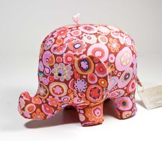 https://flic.kr/p/baxJYZ | Pink Circles Elephant Pincushion | An elephant pincushion I made using Kaffee Fassett's paprika paperweight fabric.   Elephant pattern by Heather Bailey.